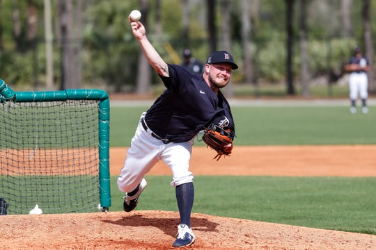 Pitcher Alex Wilson makes a throw during Detroit Tigers spring training at TigerTown in Lakeland, Fla., Wednesday, Feb. 19, 2020.