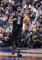 Clippers guard Derrick Walton Jr. dribbles against the Raptors on Dec. 11, 2019 in Toronto.
