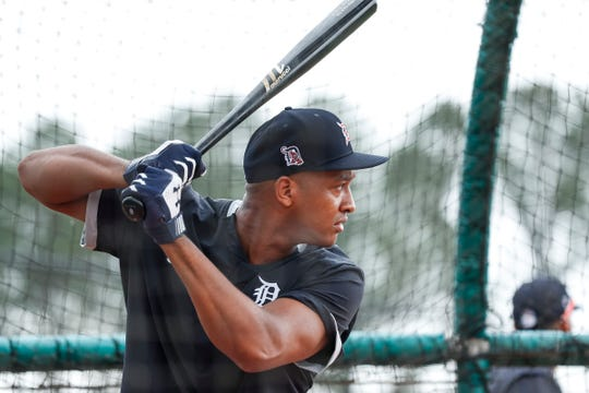 Infielder Jonathan Schoop practices in the batting cage during Detroit Tigers spring training at TigerTown in Lakeland, Fla., Thursday, Feb. 20, 2020.