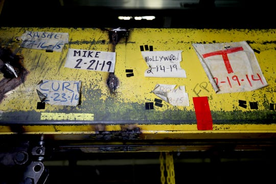 Workers who have either retired or transferred to different General Motors plants left their marks on a yellow beam in the area where 2020 Chevrolet Impala engines and transmissions are married together. This photo is from Tuesday inside the Detroit-Hamtramck Assembly plant. The Impala is nearing its end of production as the plant is being retooled and fitted for electric vehicles.
