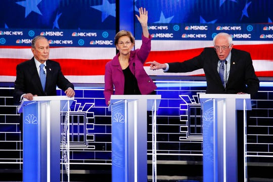 From left, Democratic presidential candidates, former New York City Mayor Mike Bloomberg, Sen. Elizabeth Warren, D-Mass., Sen. Bernie Sanders, I-Vt., participate in a Democratic presidential primary debate Wednesday, Feb. 19, 2020.
