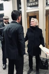 """Sen. Ruth Johnson speaks with Macomb County Executive Mark Hackel outside the State of the County address of Oakland County Executive Dave Coulter on Feb. 12. Johnson, a Holly Republican, distributed """"demand the plan"""" flyers outside the event urging residents to demand Coulter provide information on an expected regional transit tax."""