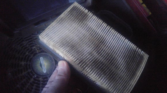 This disposable air filter has been through a couple of mowing seasons and needs to be replaced.