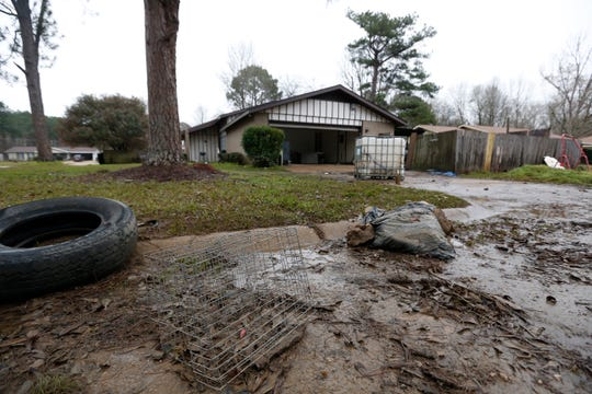 A variety of debris deposited by the floodwaters of the Pearl River, litter the streets in the northeast Jackson, Miss., neighborhoods affected by the flooding, Wednesday, Feb. 19, 2020.