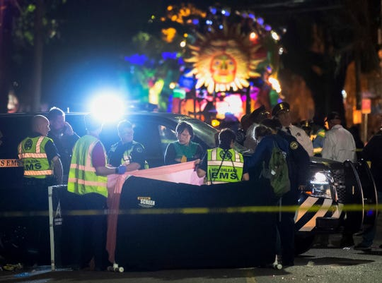 New Orleans Mayor LaToya Cantrell, center, at the scene where a  woman was run over by a float during the Mystic Krewe of Nyx parade in Mardi Gras celebrations in New Orleans on Wednesday, Feb. 19, 2020.
