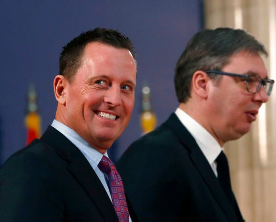U.S. President Donald Trump's envoy for the Kosovo-Serbia dialogue, Ambassador Richard Grenell, left, and Serbian President Aleksandar Vucic arrive for a news conference after their meeting in Belgrade, Serbia, in this file photo from Jan. 24, 2020.