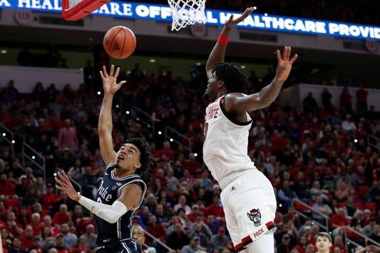 Duke guard Tre Jones drives to the basket against North Carolina State forward DJ Funderburk.