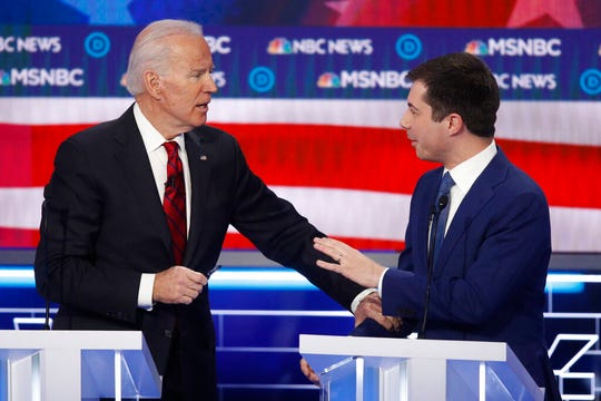 Democratic presidential candidates, Sen. former Vice President Joe Biden, left, and former South Bend Mayor Pete Buttigieg talk during the Democratic presidential primary debate.