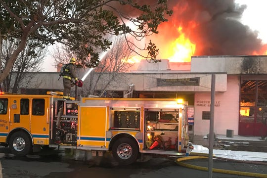 Two firefighters died battling a fire at the public library in Porterville, Calif. Two 13-year-old boys have been arrested for allegedly starting the blaze.