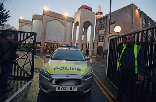 Police outside London Central Mosque in Regent's Park, where police have arrested a man on suspicion of attempted murder, in London, Thursday, Feb. 20, 2020.