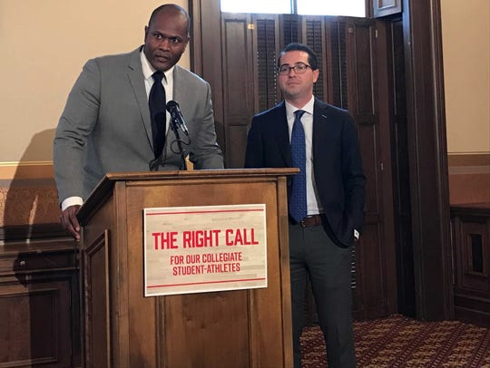 From left, Rep. Joe Tate, D-Detroit, and Rep. Brandt Iden, R-Oshtemo Township, are pushing legislation that would allow college athletes to benefit from the use of their names, images or likenesses.