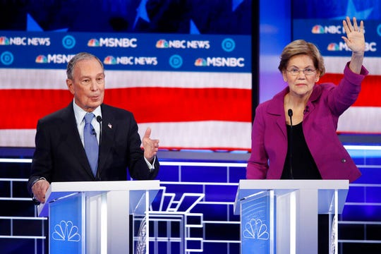 Democratic presidential candidates, former New York City Mayor Mike Bloomberg, left, speaks as Sen. Elizabeth Warren, D-Mass., gestures during a Democratic presidential primary debate Wednesday, Feb. 19, 2020, in Las Vegas.
