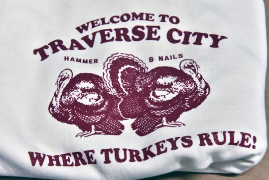 "This is the hot-selling Traverse City turkey t-shirt featuring local celebrity and traffic nuisance wild turkeys nicknamed ""Hammer"" and ""Nails"". ""Tee Cee Tee, a t-shirt company in Traverse City, Mich. makes and sells the silk-screened shirts."