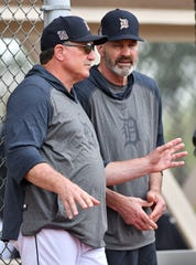 Tigers special assistants to the general manager Lance Parrish and Kirk Gibson talk during batting practice at camp Thursday.