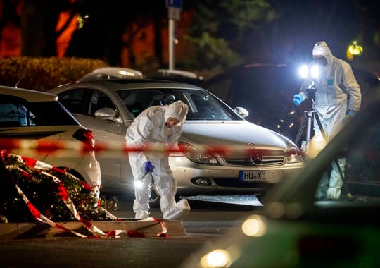 Forensics investigate the scene after a shooting in central Hanau, Germany Thursday, Feb. 20, 2020.