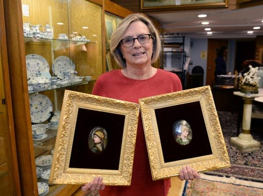 Peggy Goldberg with her plaques, passed down through generations.