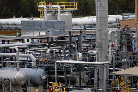 FILE - In this Thursday, Oct. 17, 2019 file photo, tanks and pipes move product through the MarkWest Bluestone Gas Processing Plant in Evans City, Pa.