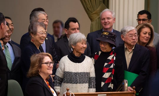 Assemblyman Al Muratsuchi, D-Torrance, in back, joins Japanese Americans who were incarcerated during World War II after the California Assembly passed House Resolution 77 on Thursday, Feb. 20, 2020, in Sacramento.
