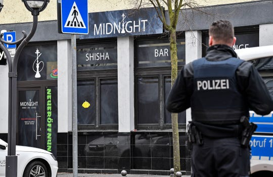 Police secure the hookah bar where several people were killed late Wednesday in Hanau, Germany, Thursday, Feb. 20, 2020.