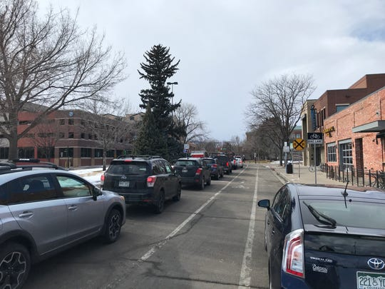 Traffic stacks up on Laporte Avenue as a long train moves through downtown Fort Collins on Feb. 12, 2020.