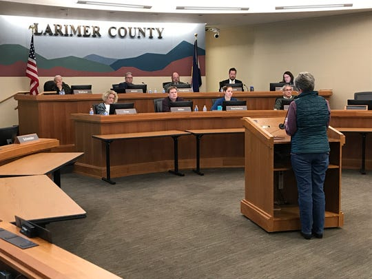 Karen Atell addresses the Larimer County Planning Commission about proposed oil and gas regulations during hearing Feb. 19.