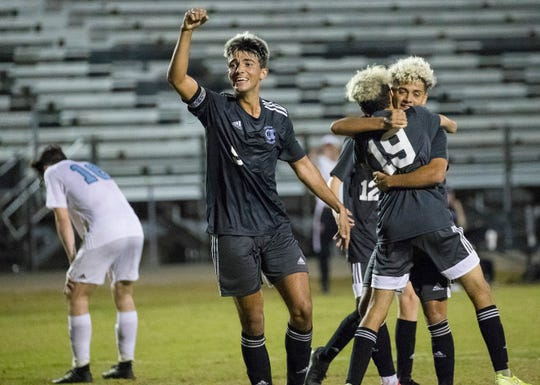 Leo Perez of Mariner High School celebrates a goal by teammate Marcel Tovar (19) against Nature Coast Tech in the Region 4A-2 boys soccer championship game on Wednesday, Feb. 19, 2020, in Cape Coral.