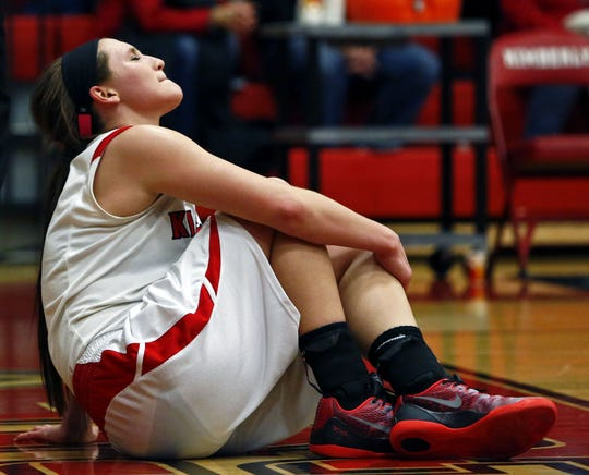 Former Kimberly star Frankie Wurtz holds her knee moments after tearing her ACL against Hortonville in December 2014. It was the final play of her high school career.