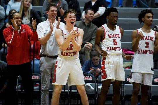 Wade Hampton's Nick Brenegan (12) celebrates during their game against Woodmont Wednesday, Feb. 19, 2020.