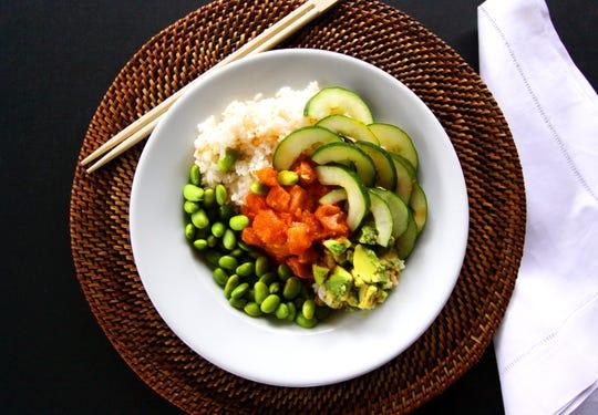 Poke Bros. signature Johnny Utah bowl with fresh salmon, avocado, cucumber, edamame and spicy aioli.