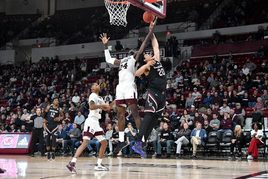 Feb 19, 2020; Starkville, Mississippi, USA; Mississippi State Bulldogs forward Abdul Ado (24) and South Carolina Gamecocks forward Alanzo Frink (20) battles for a rebound during the first half at Humphrey Coliseum.