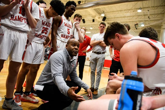 Wade Hampton head coach Reggie Choplin strategizes with his team during their game against Woodmont Wednesday, Feb. 19, 2020.