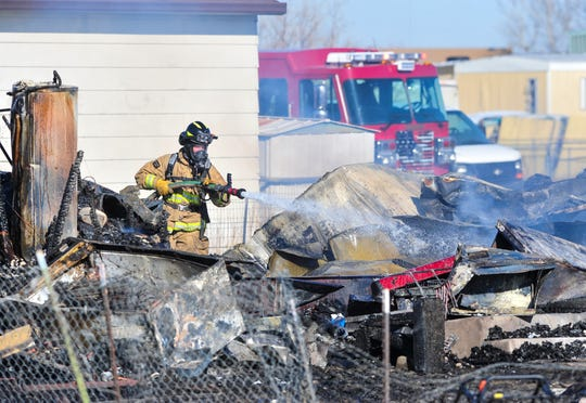 Firefighters put out hotspots at house fire on 1449 Cleveland Drive in Sun Prairie on Thursday afternoon.
