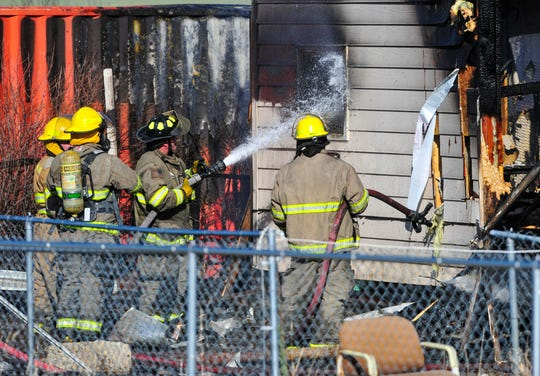 Firefighters continue to apply water to hotspots of a house fire  at 1449 Cleveland Drive in Sun Prairie on Thursday afternoon.