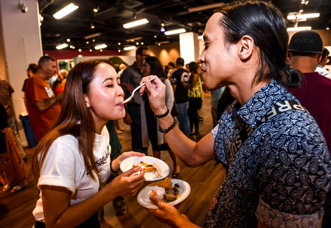 Sonja Tanabe, left, and Christian Espaldon, sample the offerings available during Pastries in Paradise 2020 at the Guam Museum in Hagåtña on Feb. 20, 2020.