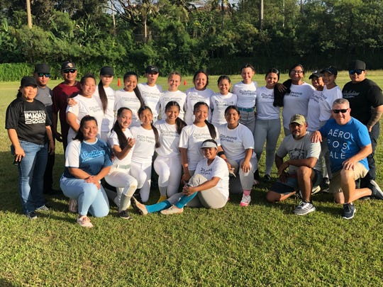 The Southern HIgh School Dolphins girls softball team gathers for a team photo after their triumphant win over the previously undefeated and two-time defending champion Academy of Our Lady of Guam Cougars Feb. 20 at the Southern High field.