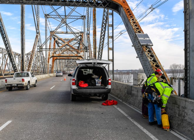 In this February, 2020 file photo, bridge inspectors with the Kentucky Transportation Cabinet prepare to rappel off one of the bridge piers on the northbound U.S. 41 Twin Bridge. Motorists can expect some delays for inspections on the twin bridges for the next couple of weeks.
