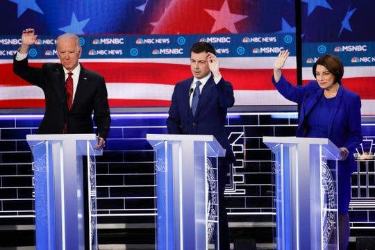 Former Vice President Joe Biden (from left), former South Bend Mayor Pete Buttigieg, Sen. Amy Klobuchar, D-Minn., gesture during a Democratic presidential primary debate Wednesday in Las Vegas.