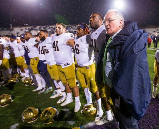 Notre Dame athletic director Jack Swarbrick (right) approves of the new transfer movement but has many questions about it as well.