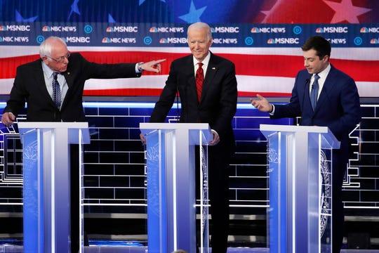 Democratic presidential candidate Sen. Bernie Sanders, I-Vt., points across former Vice President Joe Biden toward former South Bend Mayor Pete Buttigieg during a Democratic presidential primary debate Wednesday in Las Vegas.