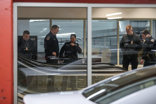 Indianapolis Metropolitan Police Department officers investigate the scene where a man was found with an apparent gunshot wound in a parking garage connected to Circle Centre Mall in downtown Indianapolis on Thursday, Feb. 20, 2020. The man died.