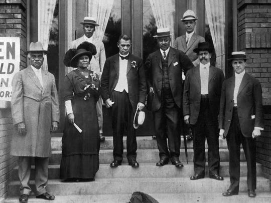 Madam C.J. Walker, second from left, poses with fellow dignitaries during the 1913 grand opening of a YMCA on Senate Avenue. Freeman Ransom, Walker's attorney, stands behind the hair-care entrepreneur. Prominent author and educator Booker T. Washington is seen third from left.