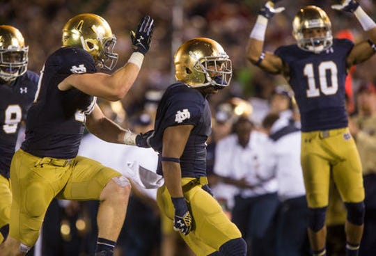 With new NCAA transfer rules seemingly imminent, Notre Dame may have to look at more incoming transfers, such as Cody Riggs (center), to make the math work.