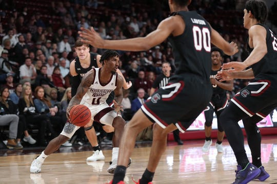 Mississippi State junior point guard Nick Weatherspoon drives against South Carolina's defense at Humphrey Coliseum on Feb. 19, 2020.