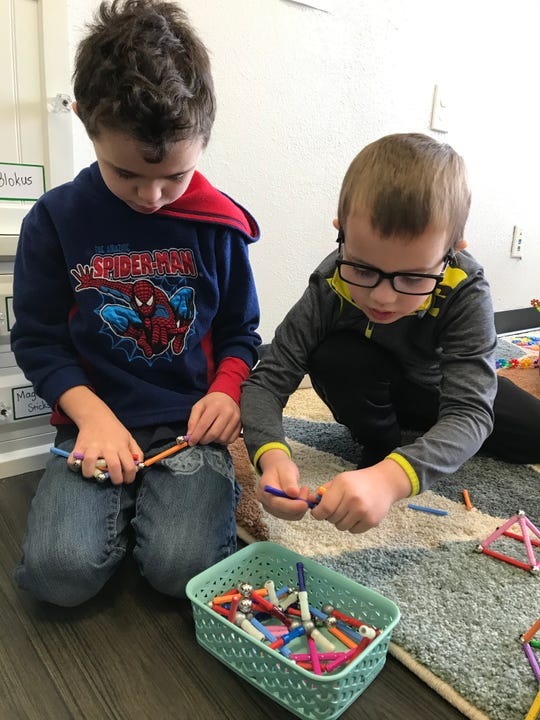 During a STEAM Play session, RJ Bumpus and John-Alan Barr use their imagination to build with Magnastix rods and bars that can connect in hundreds of combinations. (Feb 2020)