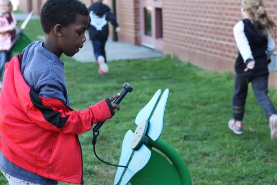 "Dogwood Elementary first grader Jordan Watson plays on one of two playground ""flowers"" that have recently been installed. Feb. 19, 2020."