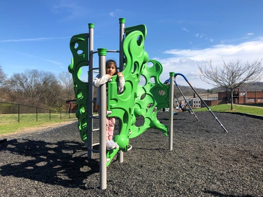 "First grader Kimberlyn Rossa-Tora plays on the new ""bubble"" climber in the prekindergarten-first grade playground at Dogwood Elementary on Feb. 19, 2020."