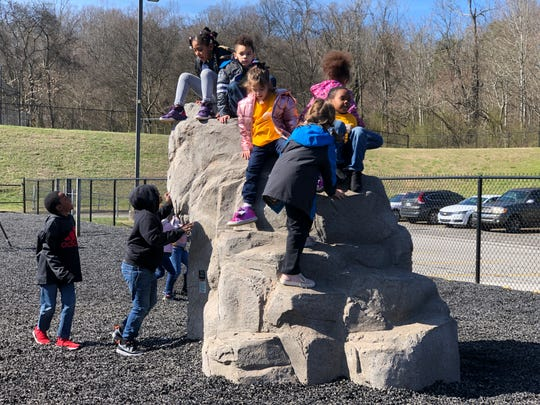 Second graders run straight to the new climbing rock at the beginning of recess on Feb. 19, 2020, at Dogwood Elementary School.