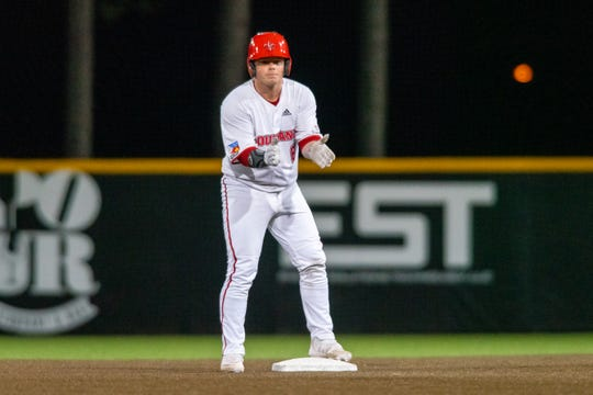 "UL's Nick Hagedorn celebrates his hit on second base as the Ragin' Cajuns take on the Tulane Green Wave at M.L. Tigue ""Moore"" Field on Wednesday, Feb. 19, 2020."