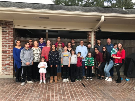 Family surrounds Sherman Billedeaux, who has a new lease on life thanks to a minimally-invasive procedure to help reduce his risk of stroke.