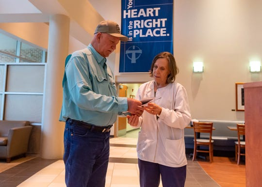 Sherman Billedeaux consults with an expert at Our Lady of Lourdes Hospital.